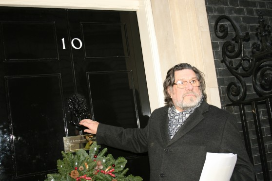Ricky Tomlinson serving the petition at 10 Downing Street, Monday 16th December 2013.