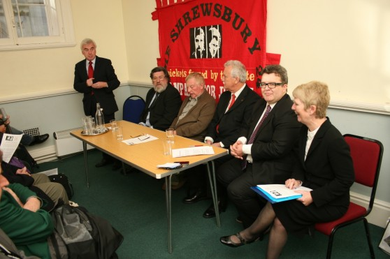 John McDonnell MP addresses the meeting alongside other members of the platform, Ricky Tomlinson, Eddie Roberts, Terry Renshaw, Tom Watson MP and Eileen Turnbull.