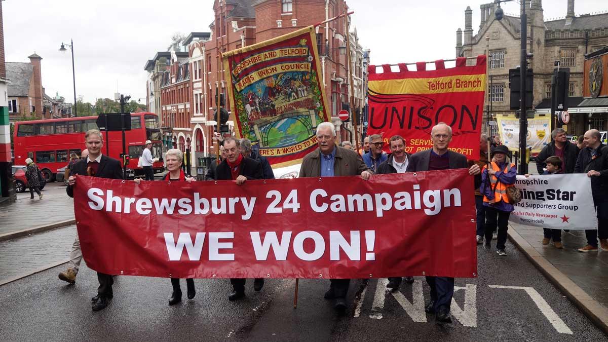 Walking with the Shewsbury 24 We Won banner through Shrewsbury.